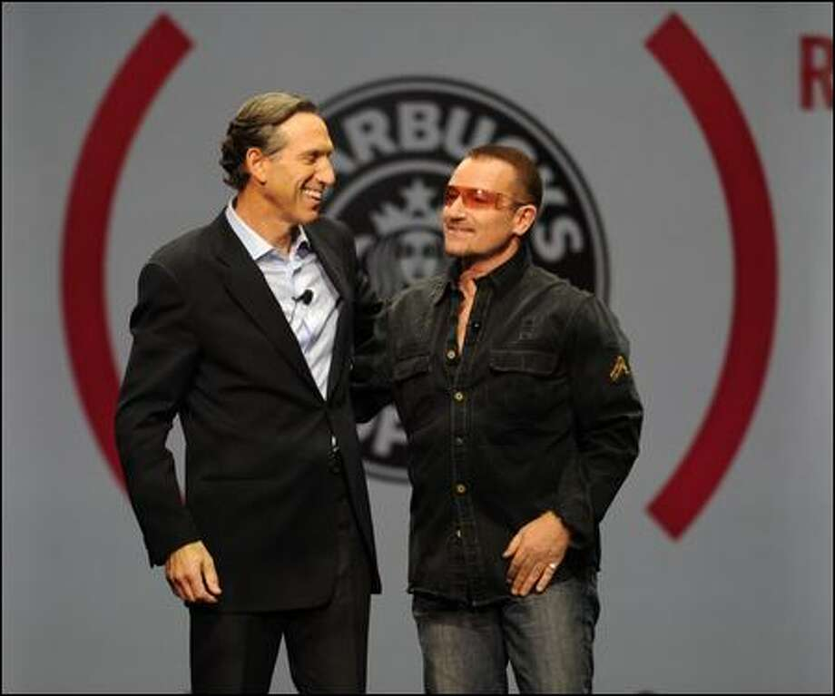 Rock star Bono's appearance, with Starbucks Chief Executive Howard Schultz, was kept secret from everyone, including his band. Photo: Starbucks