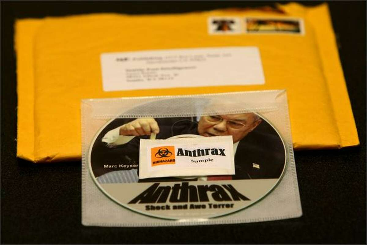 """A package labeled """"anthrax"""" sits on a counter at the photo desk of the Seattle Post-Intelligencer on Wednesday. The package was opened by a news editor and contained a disk bearing an image of Colin Powell."""