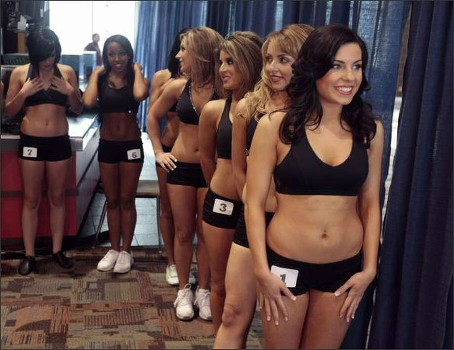 The first group of women, including Nicole, get ready to go out on stage during the Sea Gal audition at Qwest Field in Seattle. Nicole made the final team. Photo: Meryl Schenker, Seattle Post-Intelligencer