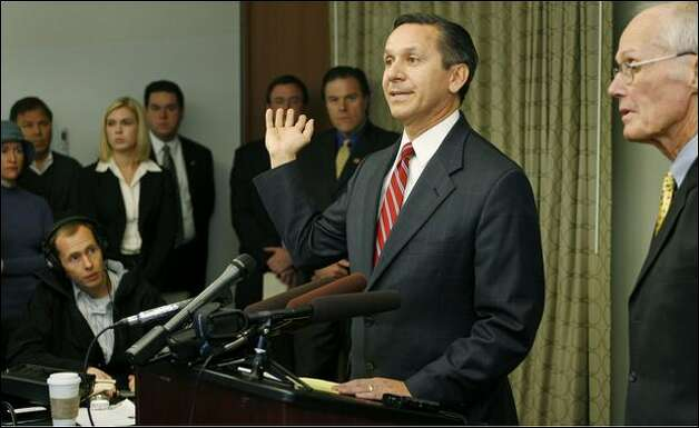 Dino Rossi speaks at a news conference Wednesday before giving a deposition concerning a lawsuit alleging illegal fundraising. At right is former U.S. Sen. Slade Gorton, who criticized the deposition's  timing. Photo: Dan DeLong/Seattle Post-Intelligencer