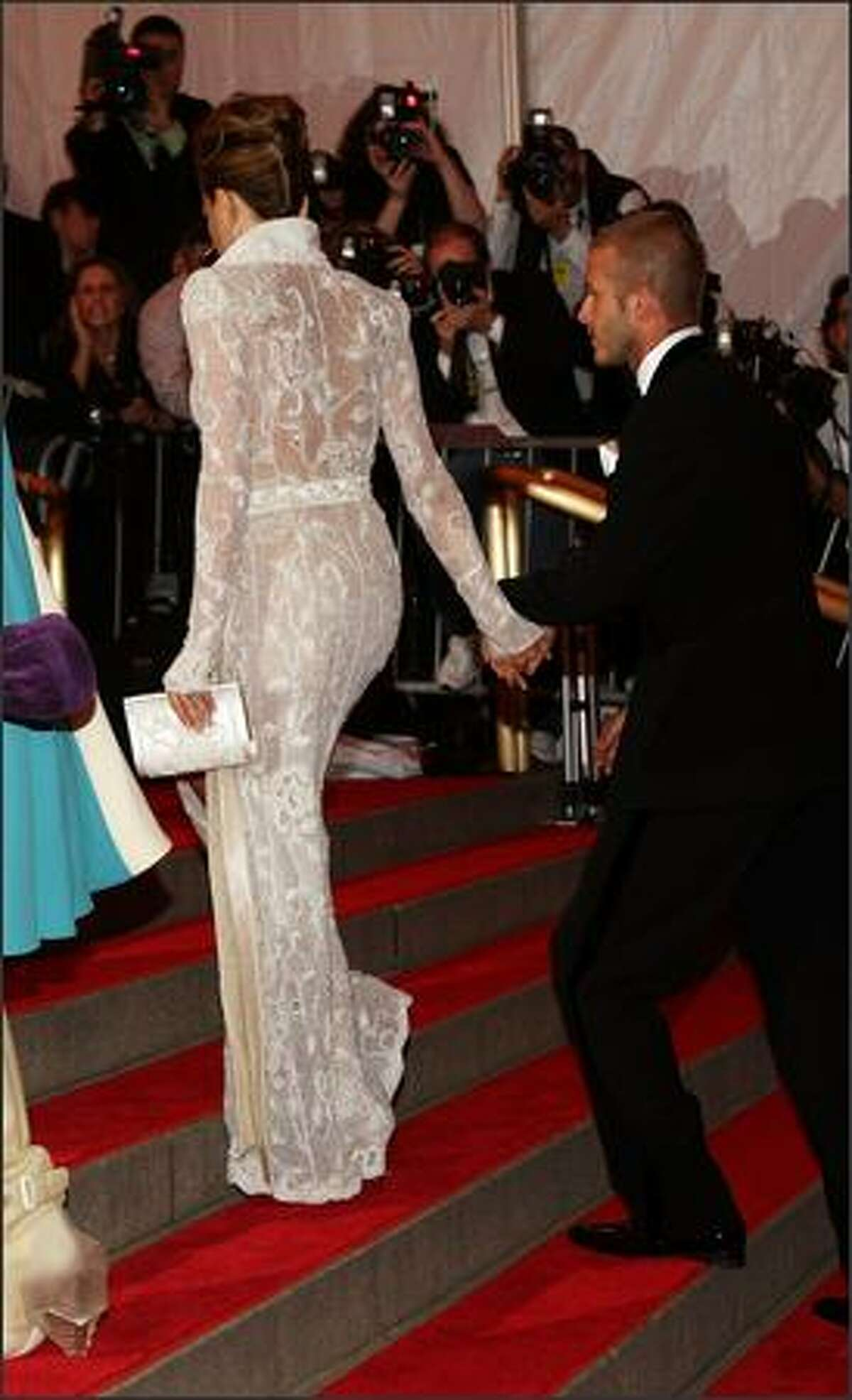 Soccer star David Beckham (right) and Victoria Beckham arrive.