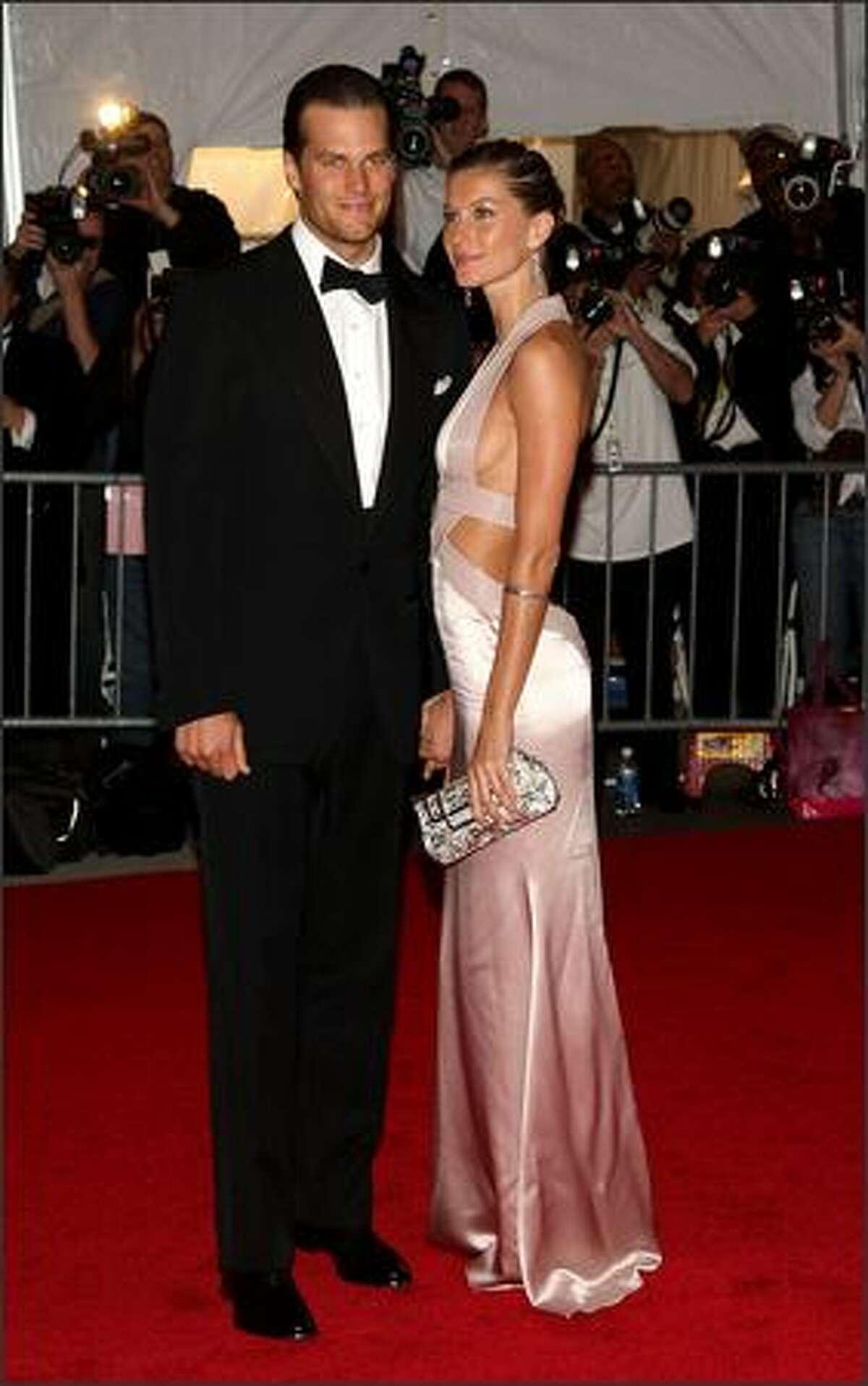 NFL player Tom Brady and model Gisele Bundchen arrive.