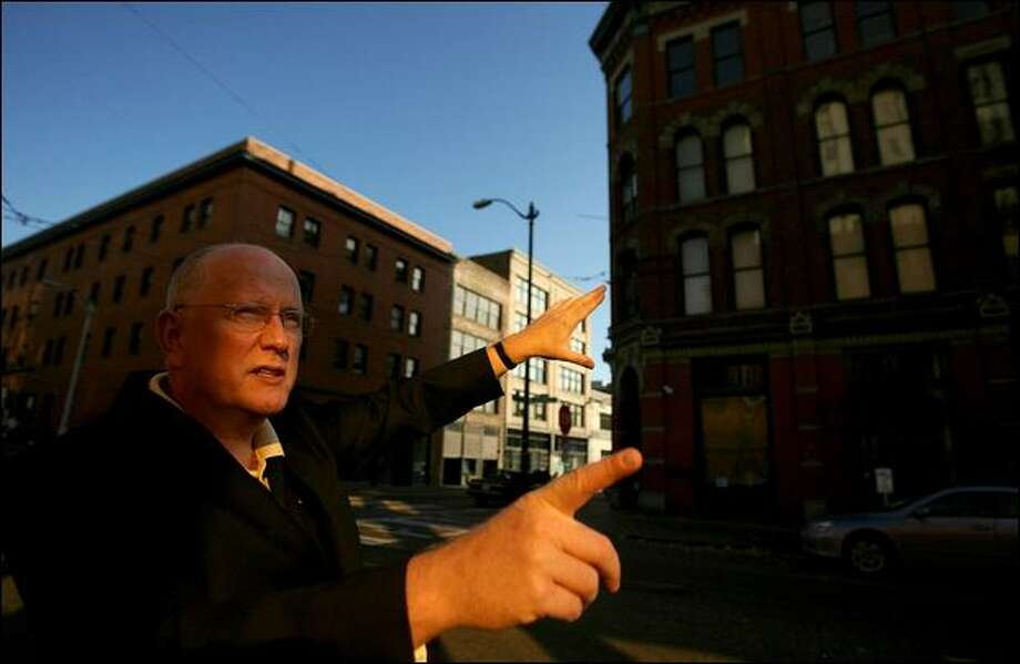 Novelist and Seattle Police Capt. Neil Low has led Pioneer Square tours of places that unsavory characters from the city's past once roamed. Photo: Scott Eklund/Seattle Post-Intelligencer