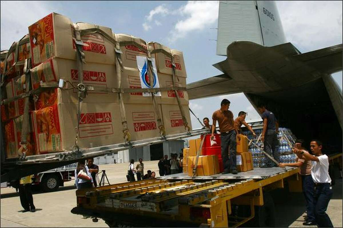 Thai workers load food items on a Royal Thai Air Force plane, destined for cyclone hit Myanmar in Bangkok. The International Federation of Red Cross and Red Crescent Societies launched an emergency appeal for almost six million USD to help cyclone victims in Myanmar. Cyclone Nargis which slammed in the southern coast has left at least 22,000 people dead and another 41,000 missing by the official count, but the toll is expected to rise. AFP PHOTO