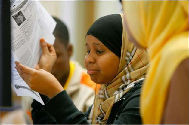 Nasro Mohamed, left, and classmate Sudi Hussein go over a voters' pamphlet Thursday during a nationwide mock presidential election at Chief Sealth High School. Photo: Gilbert W. Arias/Seattle Post-Intelligencer