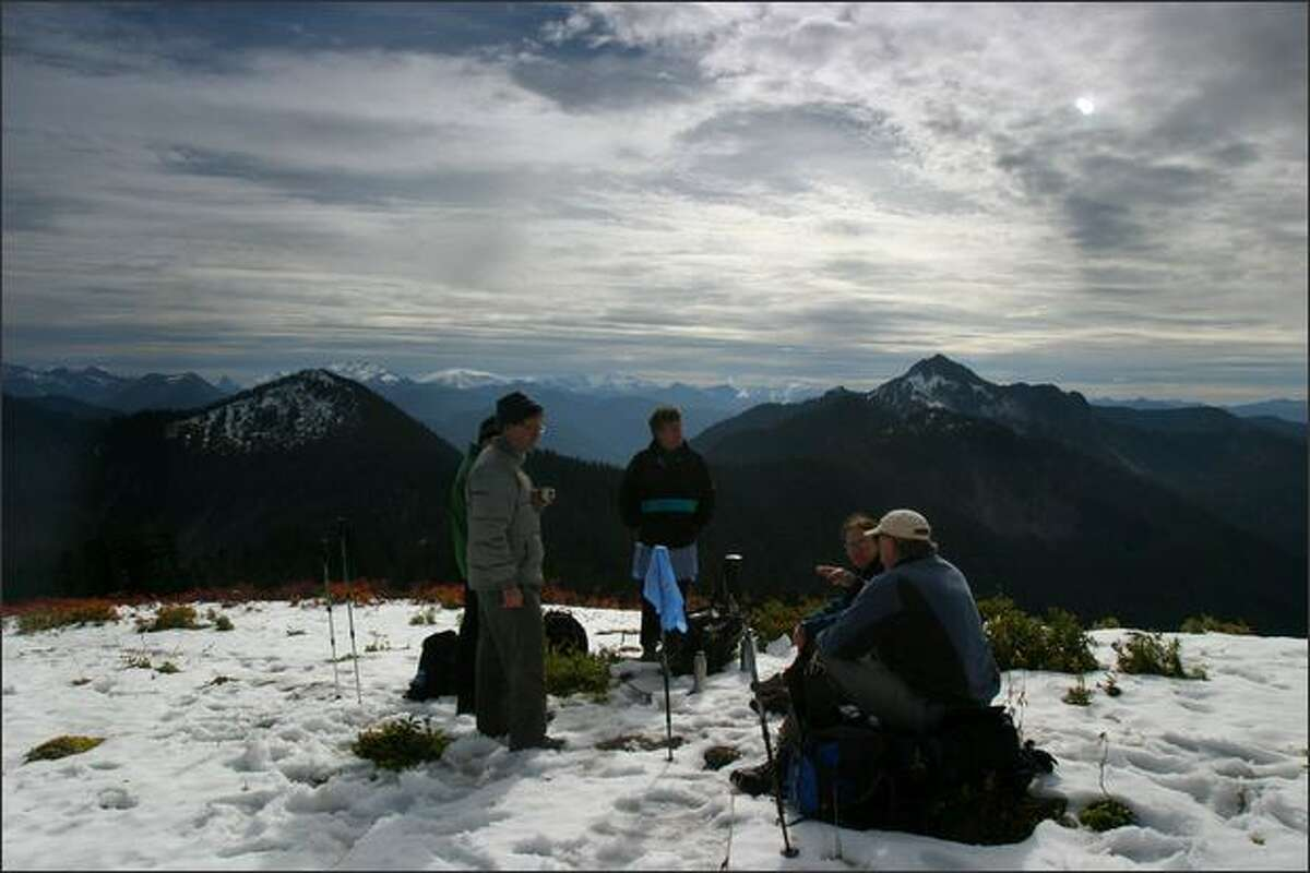 Hikers rest atop Scorpion Mountain in the Wild Sky Wilderness area during a hike. Photographed on Thursday Oct 11, 2007 near Snohomish, Wash. Nearly six years after it was first introduced, a bill to create a Wild Sky Wilderness northeast of Seattle became law on Thursday, May 8.