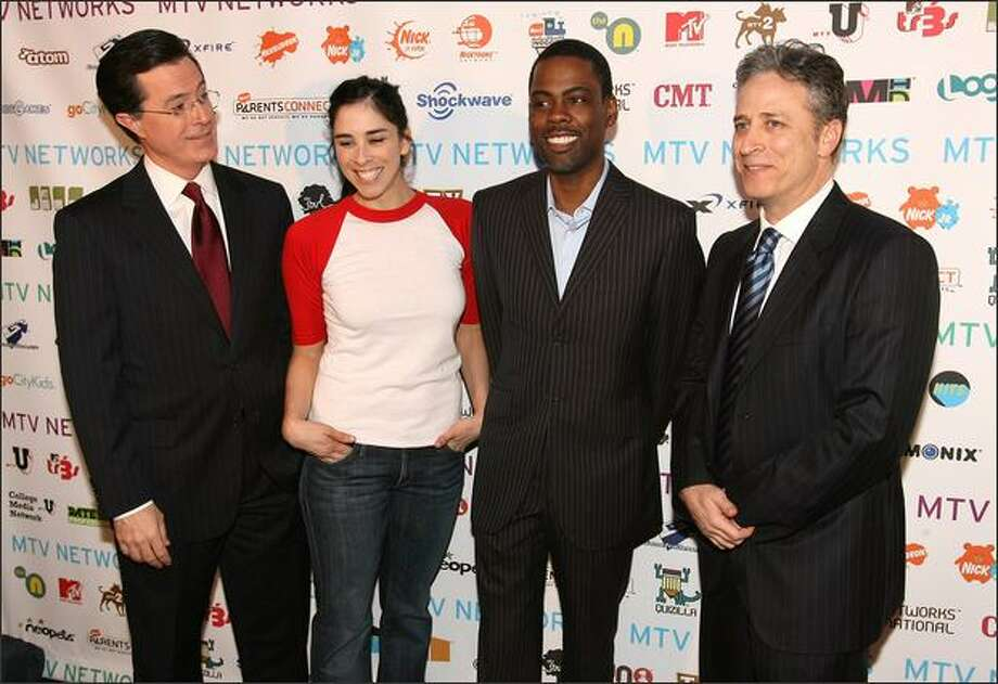 "From left, TV personality Stephen Colbert, actress Sarah Silverman, actor/comedian Chris Rock and TV personality Jon Stewart attend the MTV Networks Upfront at the Nokia Theater in New York. The New York Times describes an upfront as the network's ""pitch (to) advertisers on their programs for the coming year."" The entertainment press also is in attendance. Photo: Getty Images"