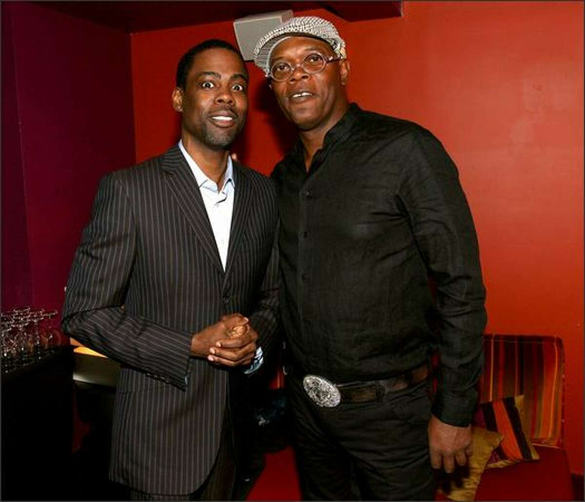 Actor/comedian Chris Rock and actor Samuel L. Jackson arrive.