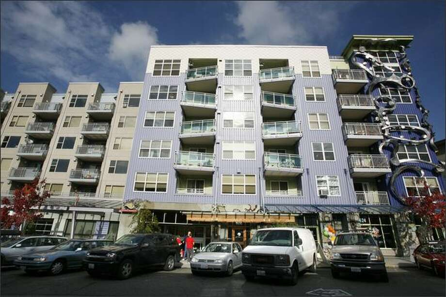 Fremont's Epi Apartments sport balconies jostling this way and that, plus a corner wrapped in otherworldy steel tentacles, in an effort to jazz up what's basically a box. Photo: Paul Joseph Brown/Seattle Post-Intelligencer