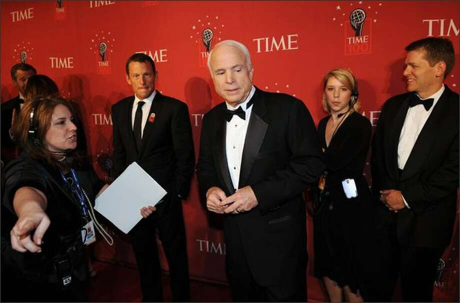 Republican presidential candidate Sen. John McCain, R-Ariz., (center) arrives at Time Magazine's 100 Most Influential People in the World dinner in New York as Tour de France champion Lance Armstrong (second left) looks on. Both were honored as among the 100 most influential people. Photo: Getty Images