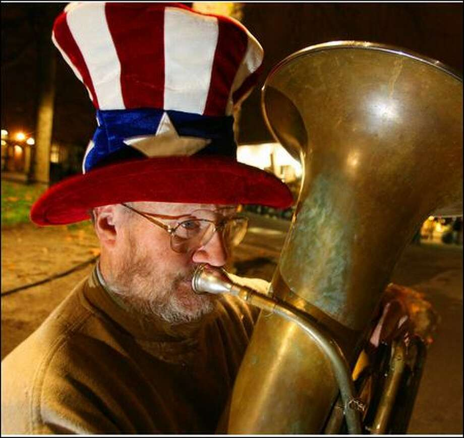 "Tuba Man for years played outside sporting events around the city, blowing dirges when the home team lost and cheerful tunes to follow victories, just for the joy of meeting the crowd. ""That's what I value most,"" he said. ""People."" Photo: Scott Eklund/Seattle Post-intelligencer/2007"