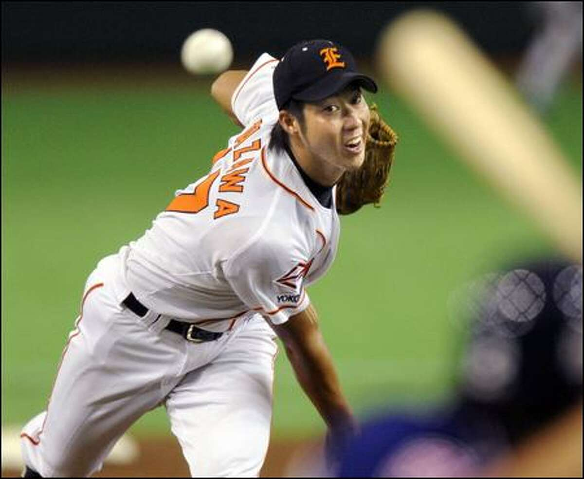Junichi Tazawa pitches for the Nippon Oil in Japan's Industrial League. The 22-year-old right-hander opted to skip the Japanese pro draft and seek an opportunity to play in the U.S.