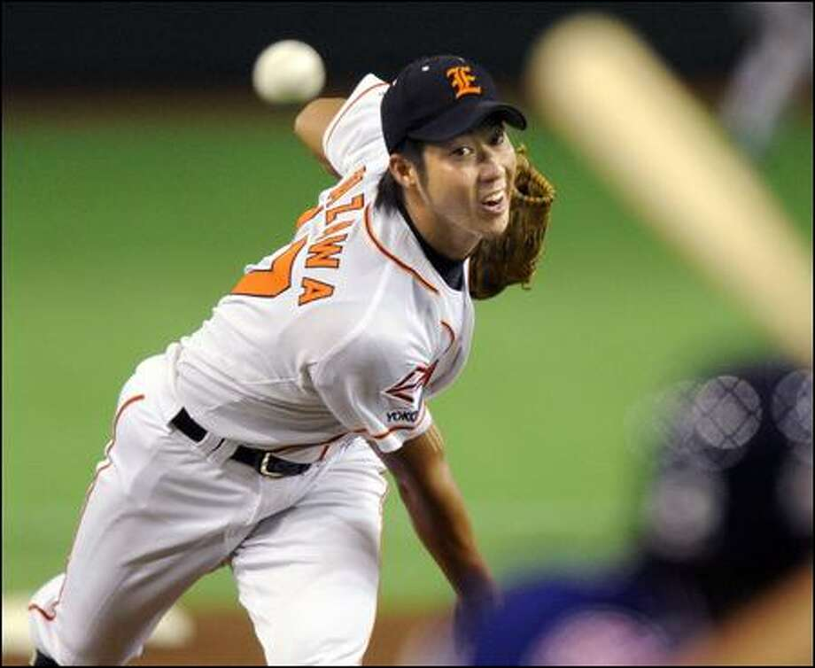 Junichi Tazawa pitches for the Nippon Oil in Japan's Industrial League. The 22-year-old right-hander opted to skip the Japanese pro draft and seek an opportunity to play in the U.S. Photo: Kyodo News/Associated Press