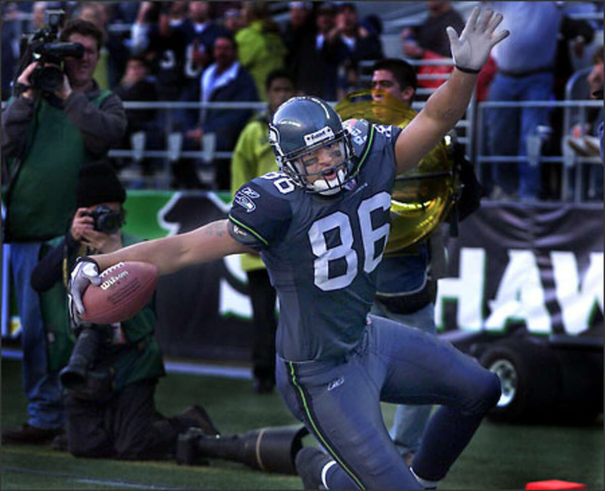 Rookie tight end Jerramy Stevens celebrates his first NFL touchdown, on a 6-yard pass from Matt Hasselbeck with 6 seconds left in the first half, giving the Seahawks the lead for good.