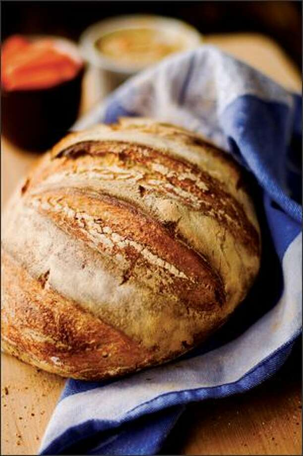 With the recipes developed by a doctor and a baker – and a little advance work – you can have a crusty loaf of fresh bread on the dinner table even on busy weeknights. Photo: Mark Luinenburg