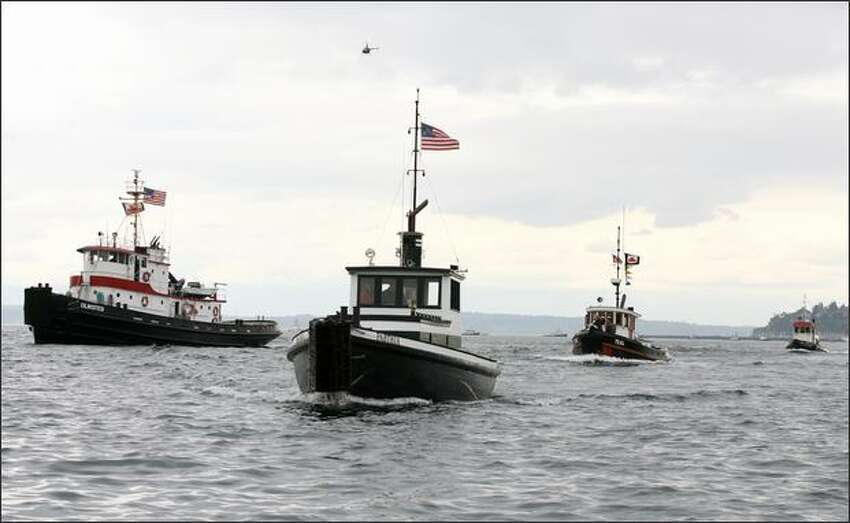 The Olmsted (left) managed to pass the Parthia to win the Class C classic tug boat race on Elliott Bay at the Seattle Maritime Festival. The 565-horsepower Olmsted won with a time of 7 minutes and 44 seconds.