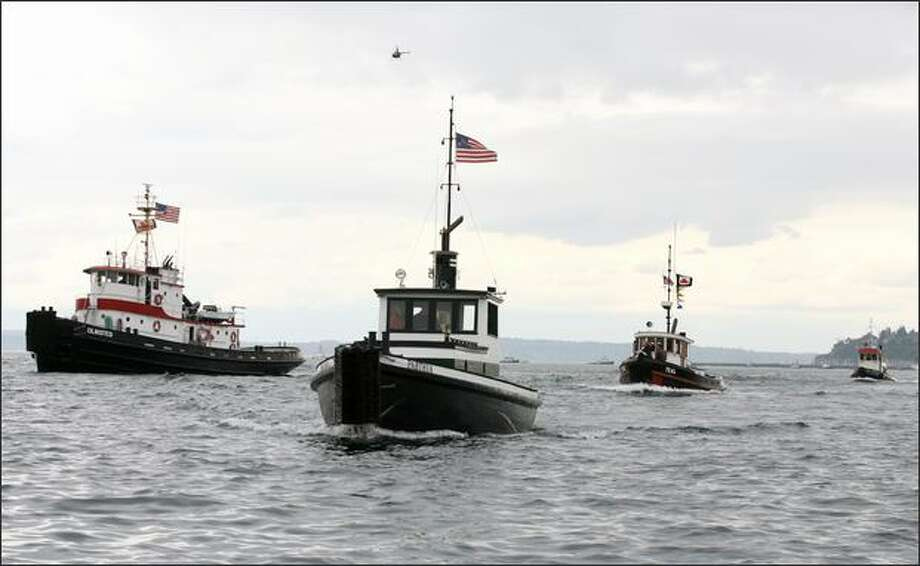 The Olmsted (left) managed to pass the Parthia to win the Class C classic tug boat race on Elliott Bay at the Seattle Maritime Festival. The 565-horsepower Olmsted won with a time of 7 minutes and 44 seconds. Photo: Dan DeLong, Seattle Post-Intelligencer