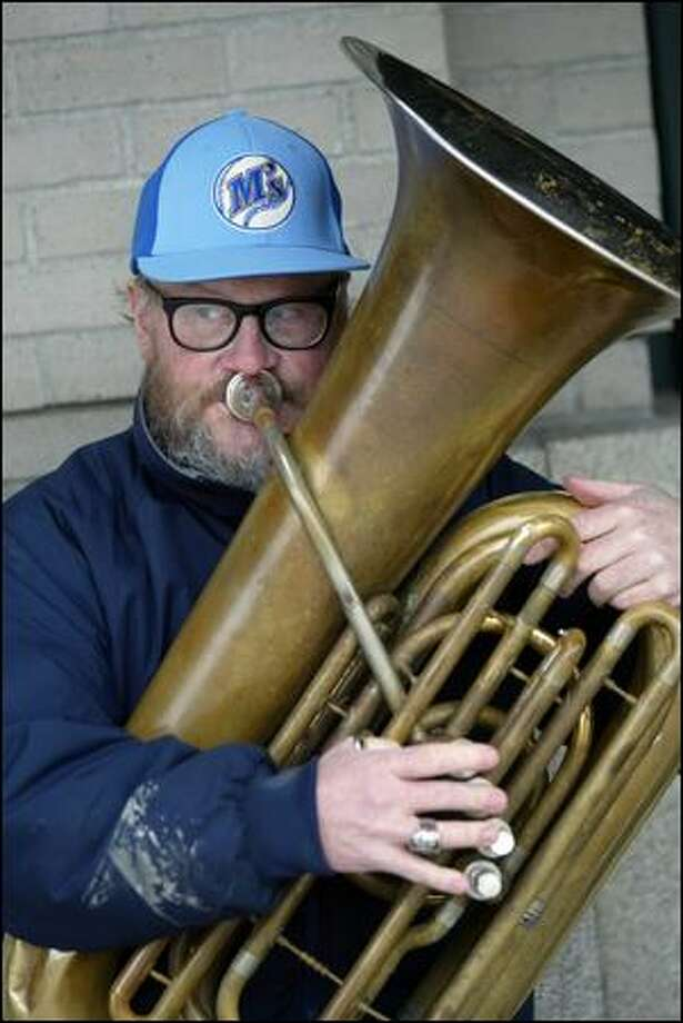 Edward McMichael and his tuba were fixtures outside Seattle sports venues and the opera house. Photo: Karen Ducey/Seattle Post-intelligencer/2006