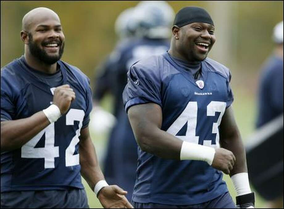 Running backs T.J. Duckett, left, and Leonard Weaver finish practice Wednesday. Weaver has been out with a sore foot. Photo: Dan DeLong/Seattle Post-Intelligencer