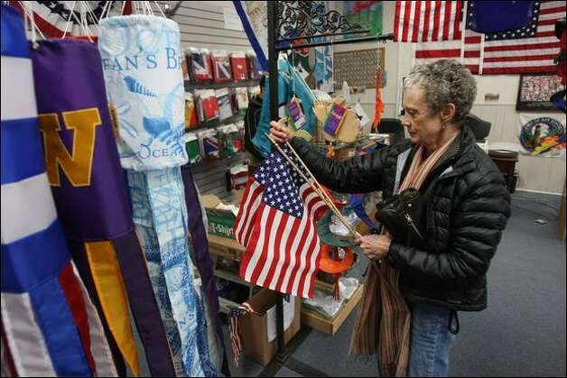 Anna Gonzalez shops for American flags at All the King's Flags in Ballard on Wednesday. Gonzalez said Barack Obama's victory inspired her to buy flags for her and her daughter's lawns. Photo: Mike Kane/Seattle Post-Intelligencer