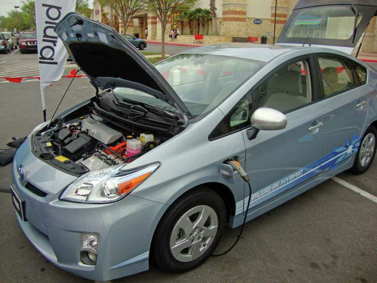 The new Toyota Prius PHV is a plug-in hybrid that can run up to 18 miles on battery power alone between recharges and can be charged in three hours with regular 110-volt household current. This one was on display recently at The Rim shopping center.