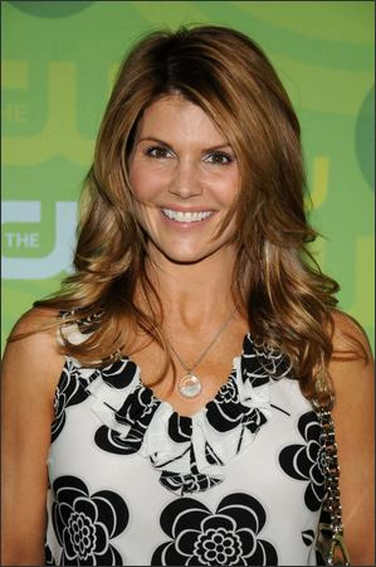 Actress Lori Loughlin arrives at the CW Network's Upfront at Lincoln Center on Tuesday in New York City.