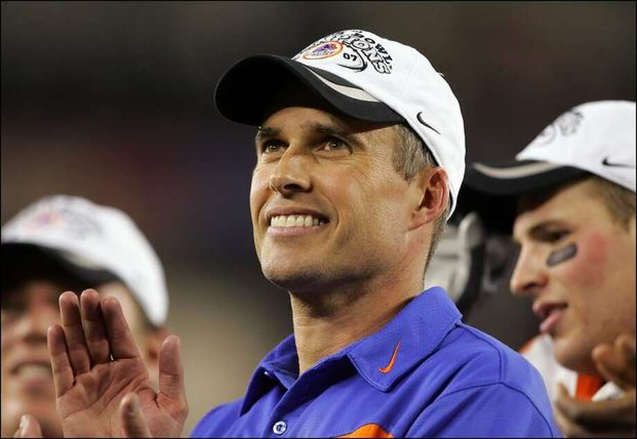 Boise State's Chris Petersen says he's happy with the Broncos, yet one wonders how he'd feel as the coach of a BCS conference school. Photo: Lisa Blumenfeld/Getty Images