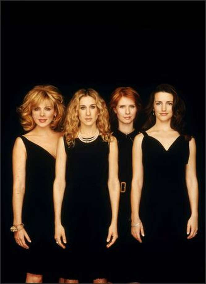"From left, Kim Cattrall as ""Samantha Jones,"" Sarah Jessica Parker as ""Carrie Bradshaw,"" Cynthia Nixon as ""Miranda Hobbs"" and Kristin Davis as ""Charlotte York"" pose for a promotional portrait for HBO, which aired ""Sex and the City"" for six seasons, beginning June 6, 1998. The series, which makes a comeback on May 30 with ""Sex and the City: The Movie"" in U.S. theaters, won seven Emmys and eight Golden Globes. Photo: Getty Images"