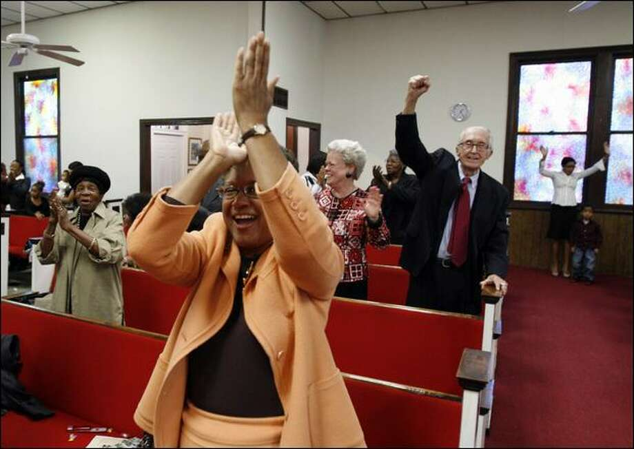 Worshippers celebrate during a sermon Sunday at the Hungary Road Baptist Church in Richmond, Va. Photo: Steve Helber/Associated Press
