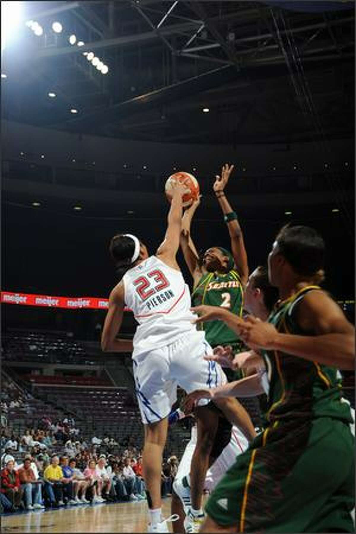 Swin Cash #2 of the Seattle Storm is blocked by Plenette Pierson #23 of the Detroit Shock in Wednesday's game.