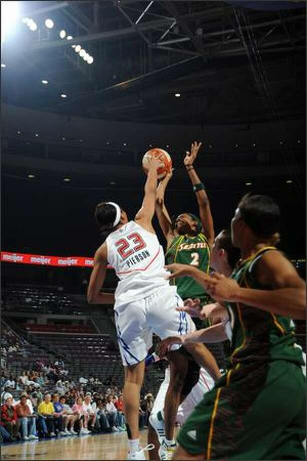 Swin Cash #2 of the Seattle Storm is blocked by Plenette Pierson #23 of the Detroit Shock in Wednesday's game. Photo: Getty Images
