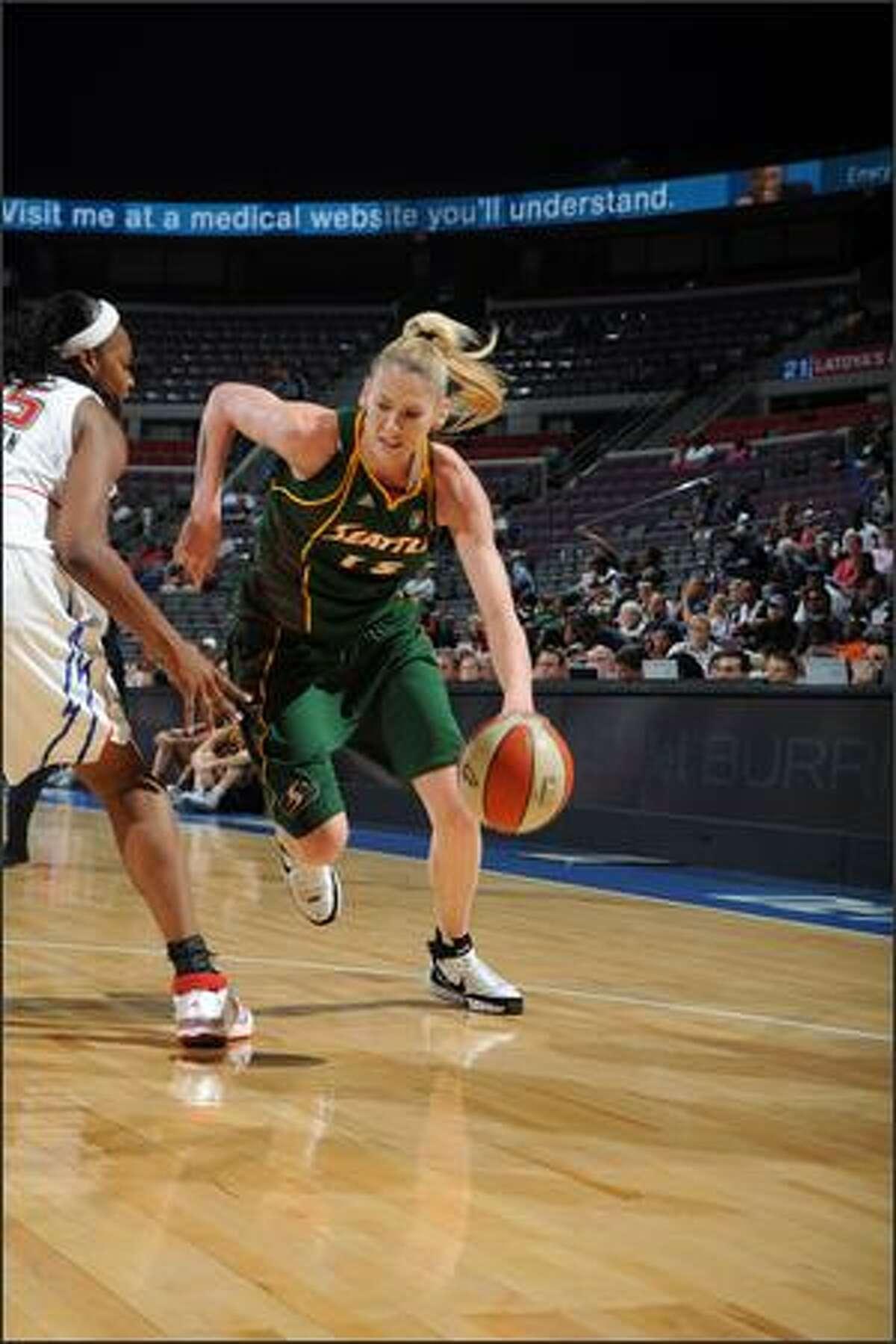 Storm forward Lauren Jackson drives against Kara Braxton of Detroit. Jackson led the Storm with 27 points,