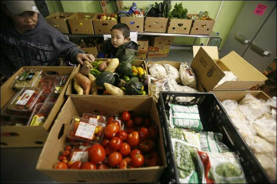 The University District Food Bank serves more than 900 families each week, providing a variety of foods. Photo: Paul Joseph Brown/Seattle Post-Intelligencer