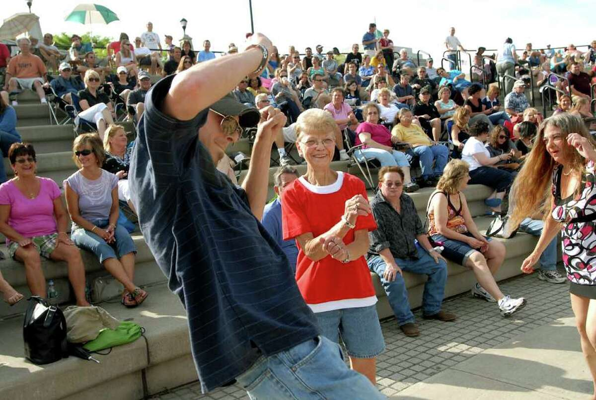 Mark Collins of Troy, left, dances with Gail Walsh of Latham, center, to the music of the band Cryin' Out Loud during Alive at Five on Thursday, June 3, 2010, at Riverfront Park in Albany, N.Y. (Cindy Schultz / Times Union)