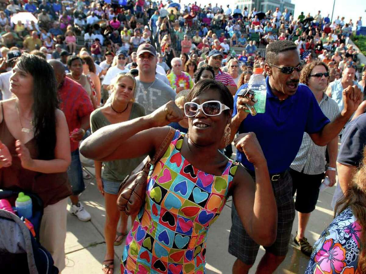 Carolyn London of Watervliet, center, and her twin brother Alvin of Schenectady, right, groove to the music of the opening band Solid Smoke during Alive at Five on Thursday, July 31, 2008, at the Corning Preserve in Albany, N.Y. (Cindy Schultz / Times Union Archive)