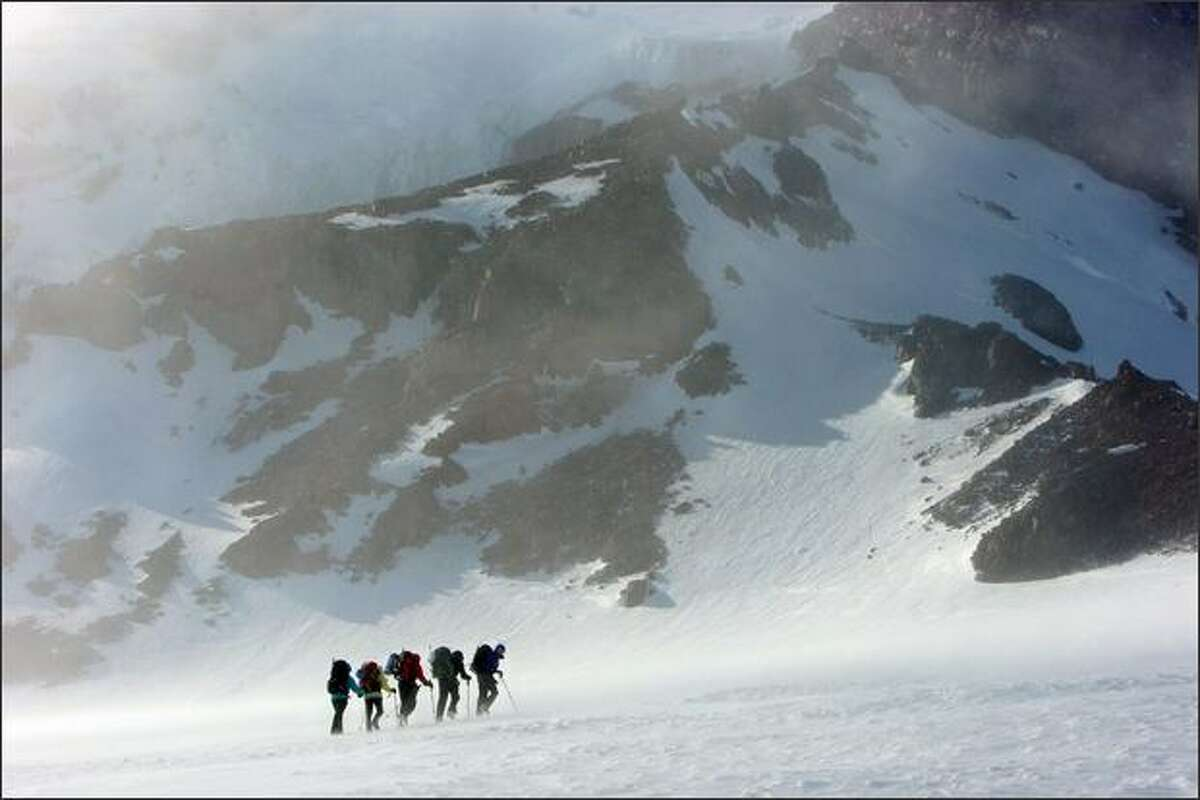 Members of the Fred Hutchinson Cancer Research Center's Big Expedition team climb to base camp, Camp Muir, on Mount Rainier. They are training for a virgin ascent of an unnamed, 8,300 ft. peak in Glacier Bay National Park, Alaska to take place later this summer.