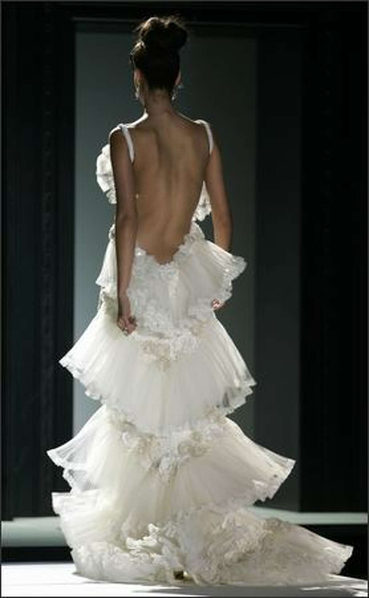 Models present wedding gowns by Spanish designer Pepe Botella during Barcelona Bridal fashion week.