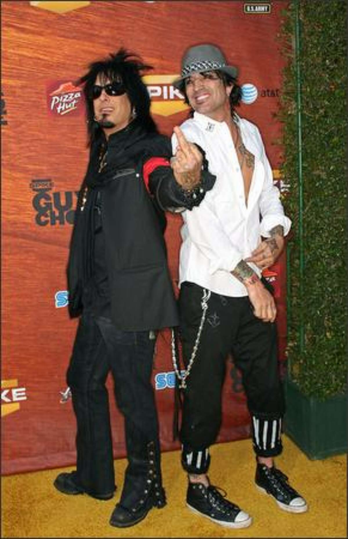 Musicians Nikki Sixx (left) and Tommy Lee arrive.