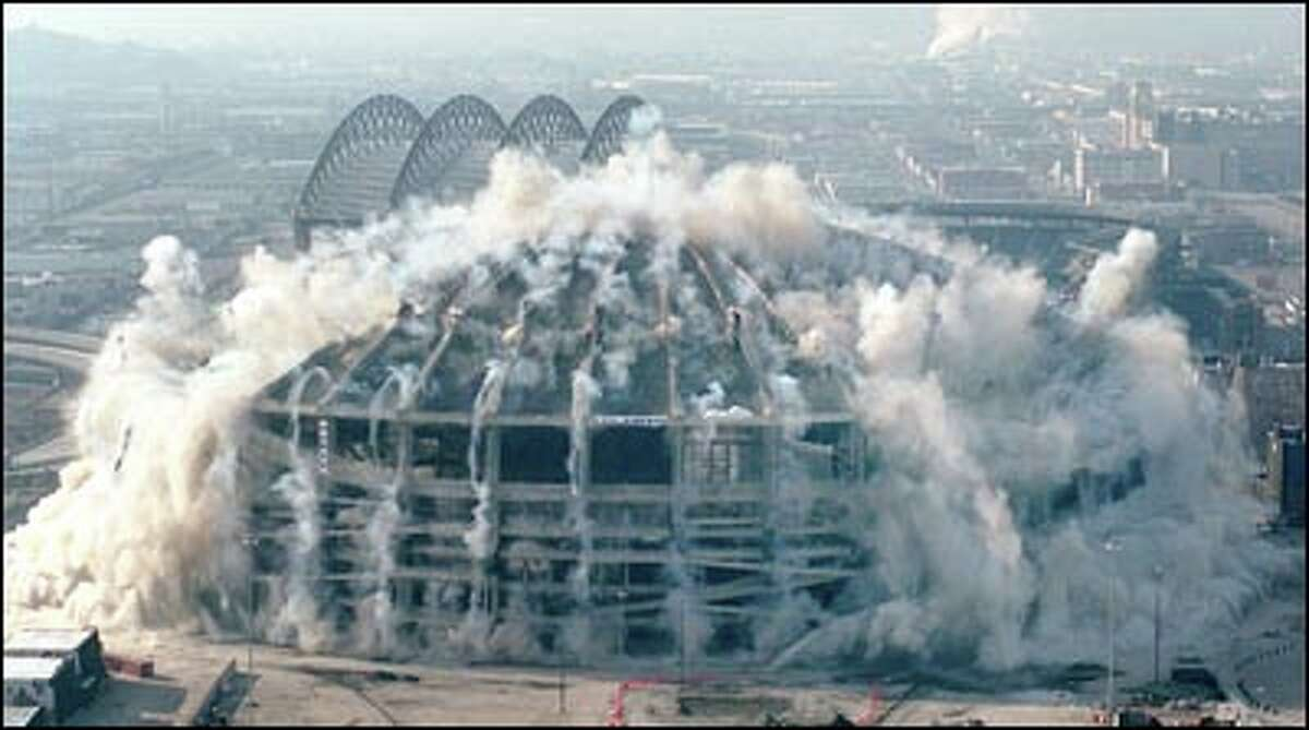 The walls of the Dome buckle as explosive charges demolish their supports.