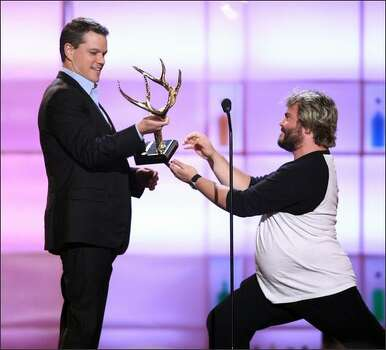 "Actor Matt Damon accepts the ""Man of the Year"" award from actor Jack Black. Photo: Getty Images"