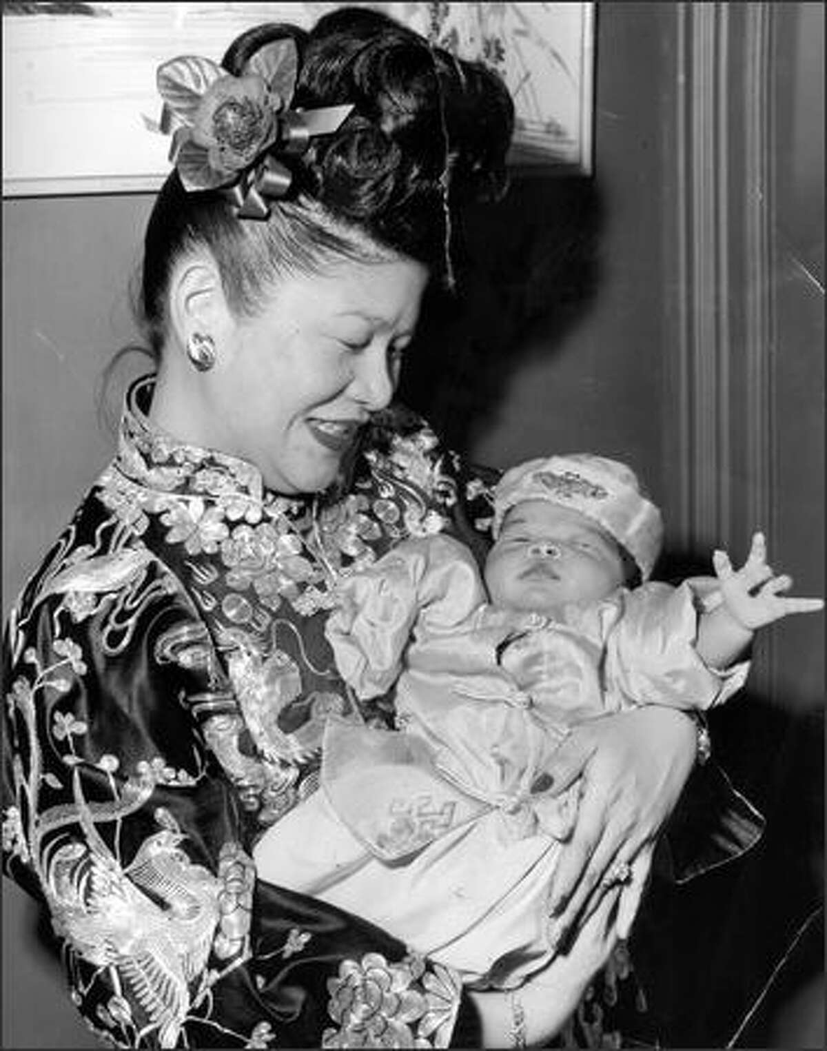 Ruby Chow with son Brien at his traditional chrising ceremony in 1951