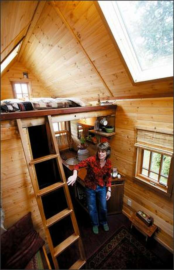 Dee Williams lives in a 7-by-12-foot Tumbleweed Tiny House in Olympia that was built for $10,000, including solar panels, ecofriendly denim insulation, high-quality wood windows and a trailer. Photo: Scott Eklund, Seattle Post-Intelligencer
