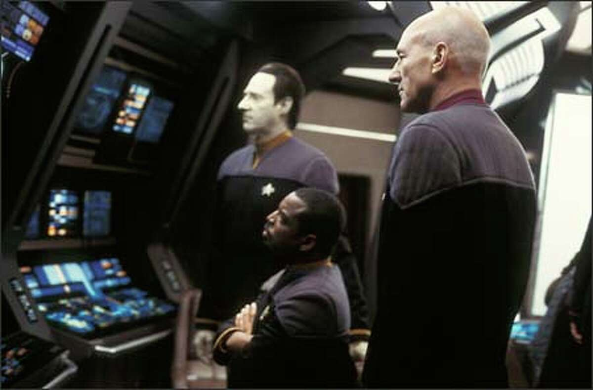 Data (Brent Spiner), Geordi La Forge (LeVar Burton) and Picard (Patrick Stewart) aboard the Enterprise.