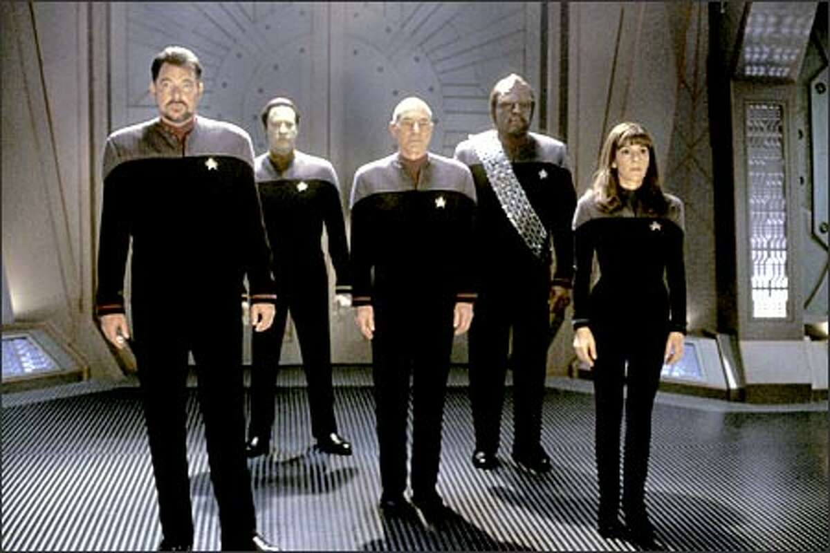 Together again (for the last time?), the crew of the USS Enterprise: (left to right) Cmdr. William T. Riker (Jonathan Frakes), Ltd. Cmdr. Data (Brent Spiner), Capt. Jean-Luc Picard (Patrick Stewart), Lt. Cmdr. Worf (Michael Dorn) and Counselor Deanna Troi (Marina Sirtis).