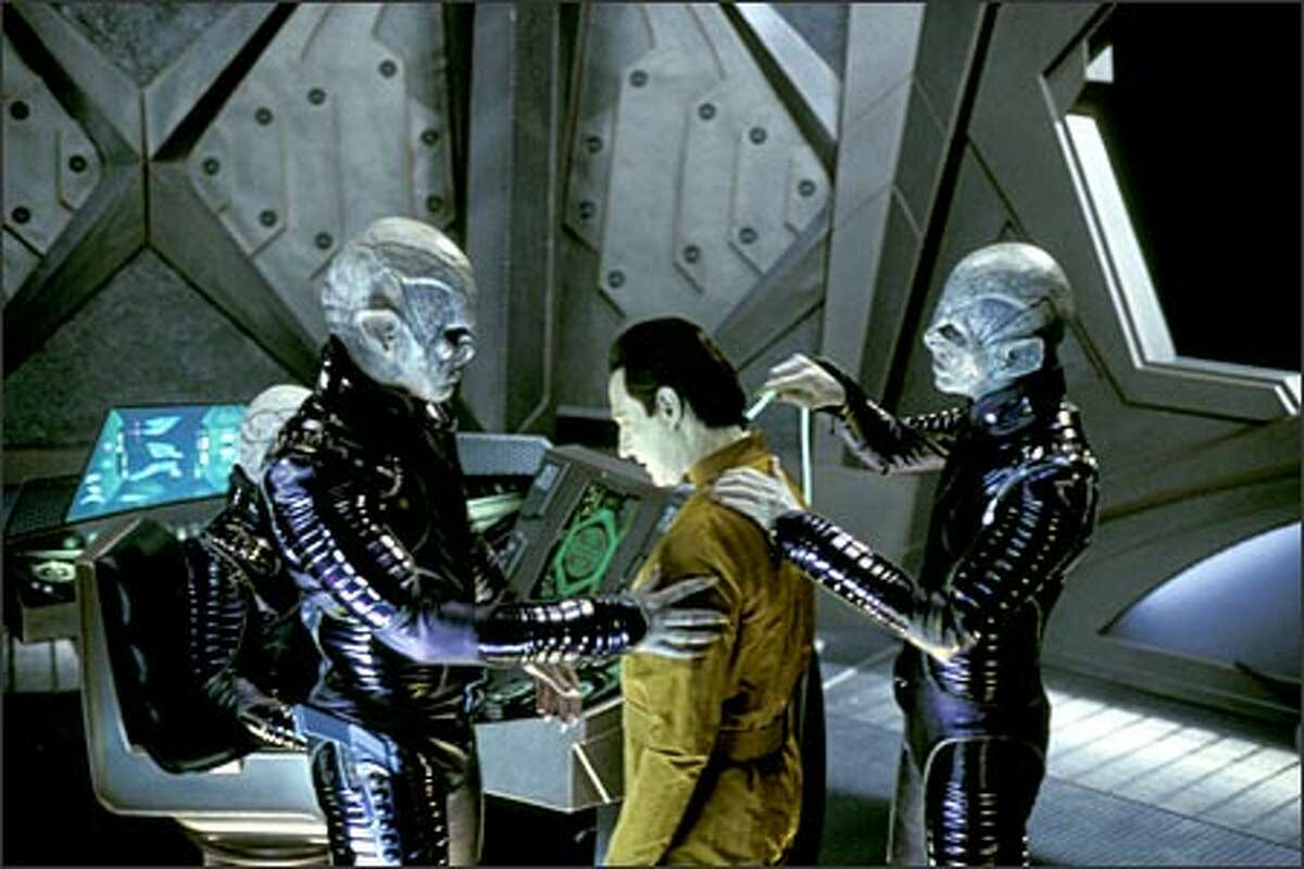 Two Remans and a Soong-type android.