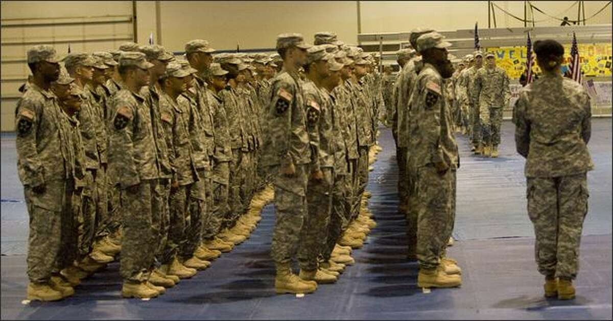 Members of the 4th Styker Brigade Combat Team, 2nd Infantry Division, wait in formation during a ceremony marking their return from Iraq.