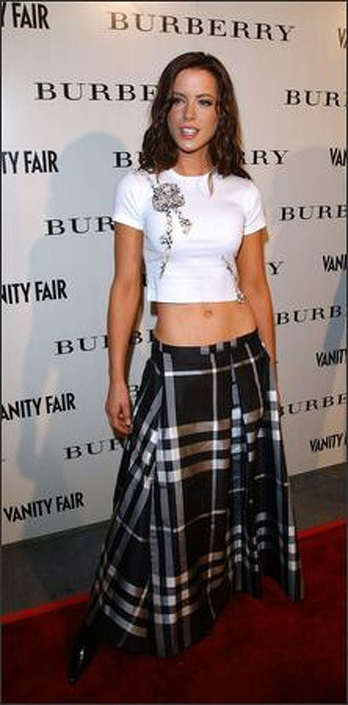 Kate Beckinsale attends the grand opening of the Los Angeles Burberry store Oct. 25, 2001 in Beverly Hills, Calif. The event benefitted the Shakespeare Festival L.A.