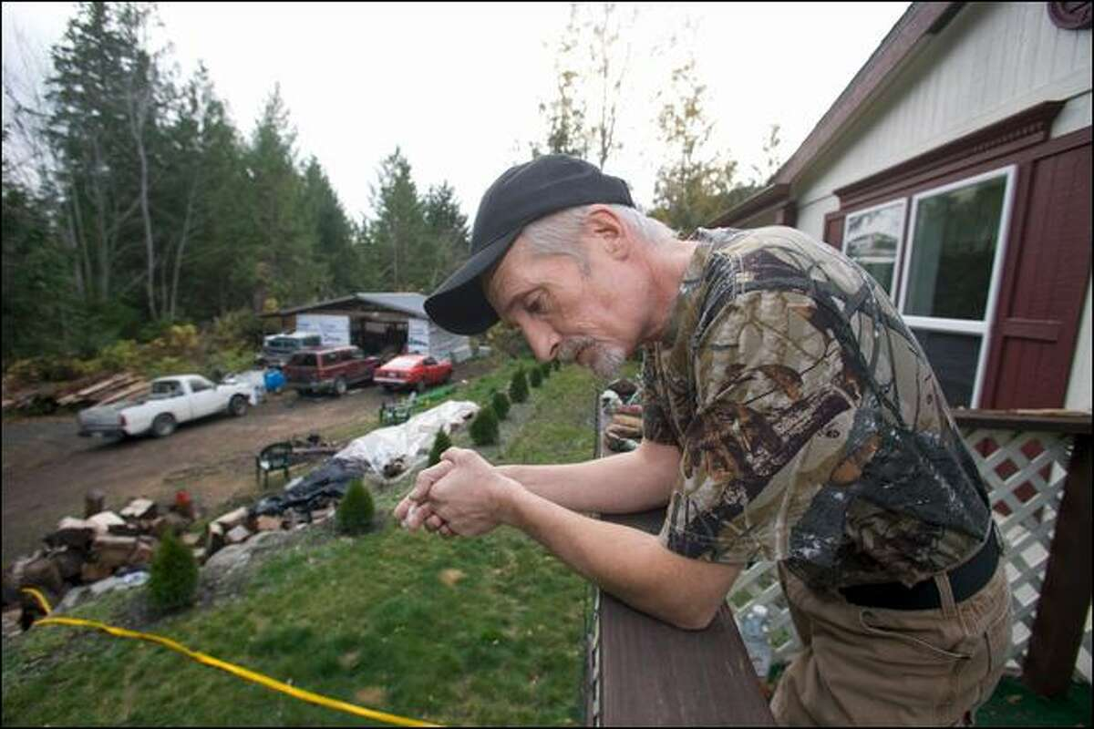 Steve Dixon, shown outside his Brinnon home, was pulled over by the U.S. Border Patrol in August and busted for having 3 grams of medical marijuana. The charge against him was dismissed Wednesday.