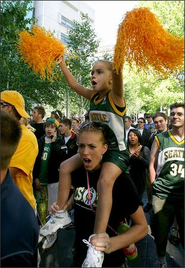 "Seattle Sonics fans Rylee Reese, 5, and mother Emily Reese chant ""Save Our Sonics,"" to show support for keeping the Sonics in Seattle. Photo: Scott Eklund, Seattle Post-Intelligencer"