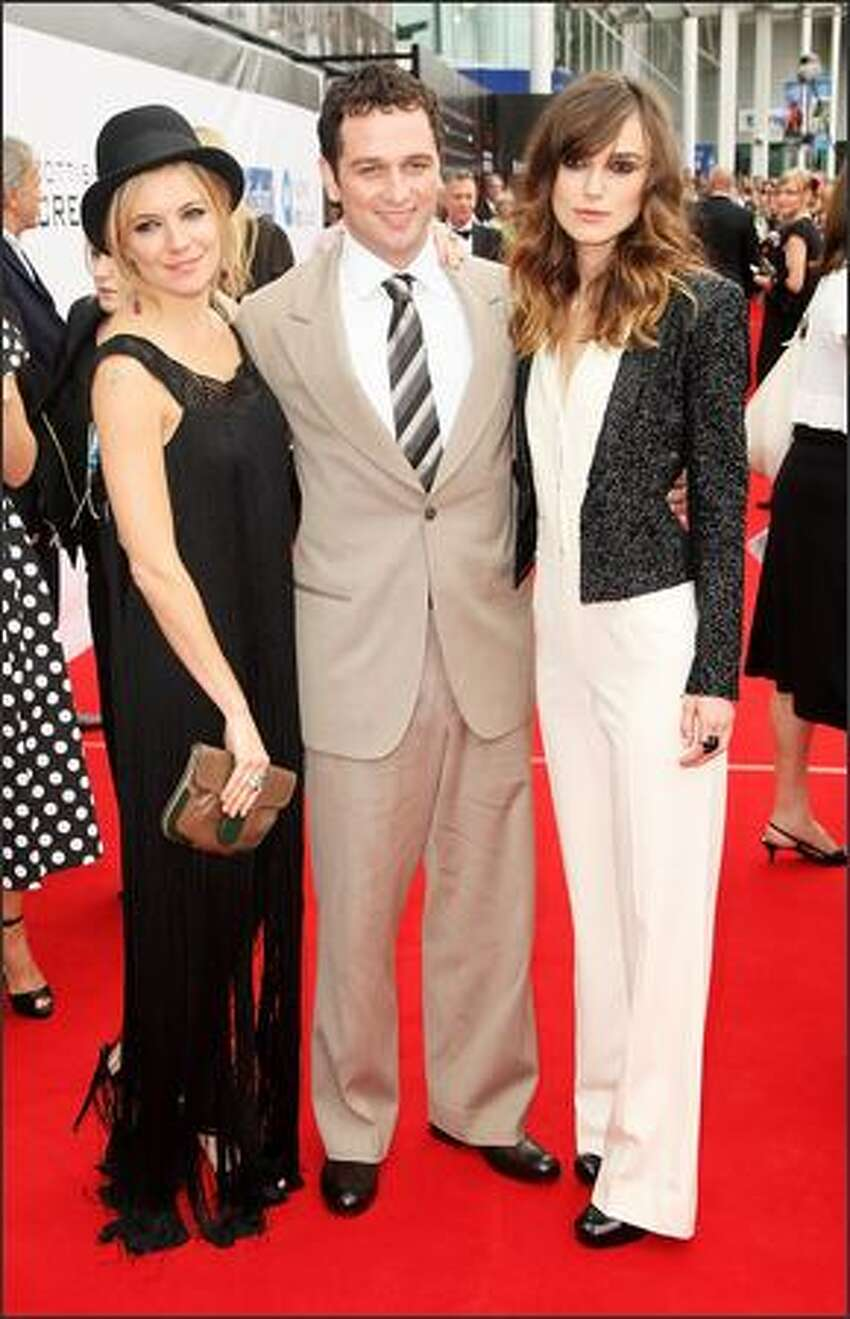 Actors (L-R) Sienna Miller, Matthew Rhys and Keira Knightley arrive at the world premiere of 'The Edge Of Love', on the opening night of the 62nd Edinburgh International Film Festival, at Cineworld, Fountain Park on Wednesday in Edinburgh, Scotland.